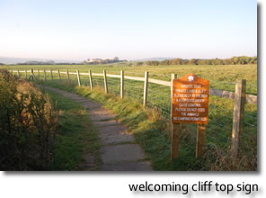 welcoming cliff top sign!